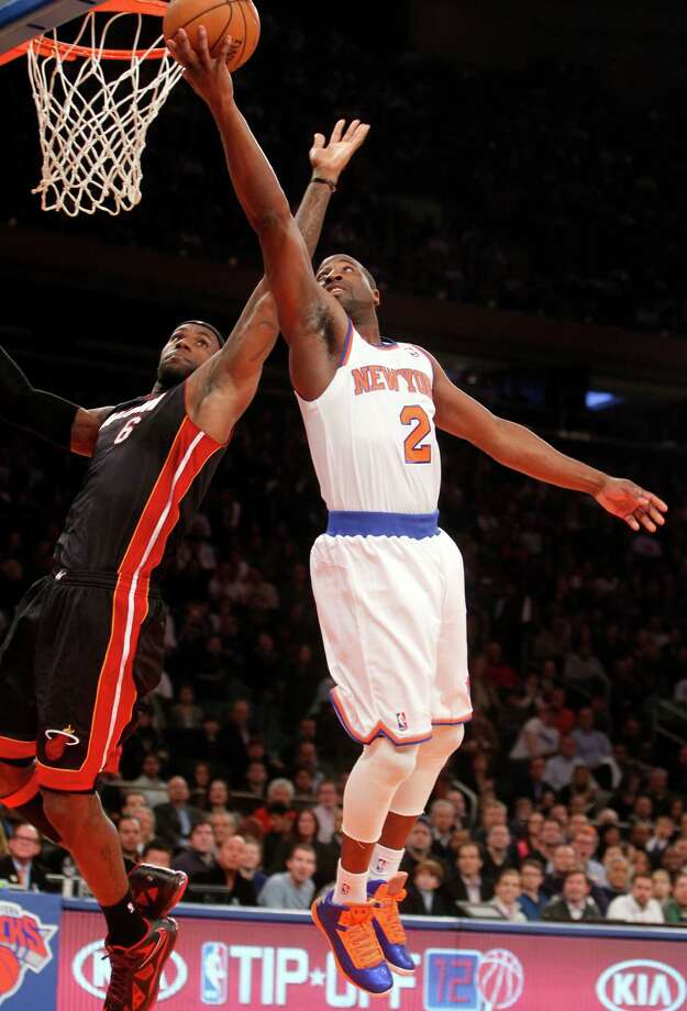 New York Knicks' Raymond Felton (2) shoots against Miami Heat's LeBron James (6) during the first half of an NBA basketball game, Friday, Nov. 2, 2012, in New York. (AP Photo/Jason DeCrow) Photo: JASON DECROW