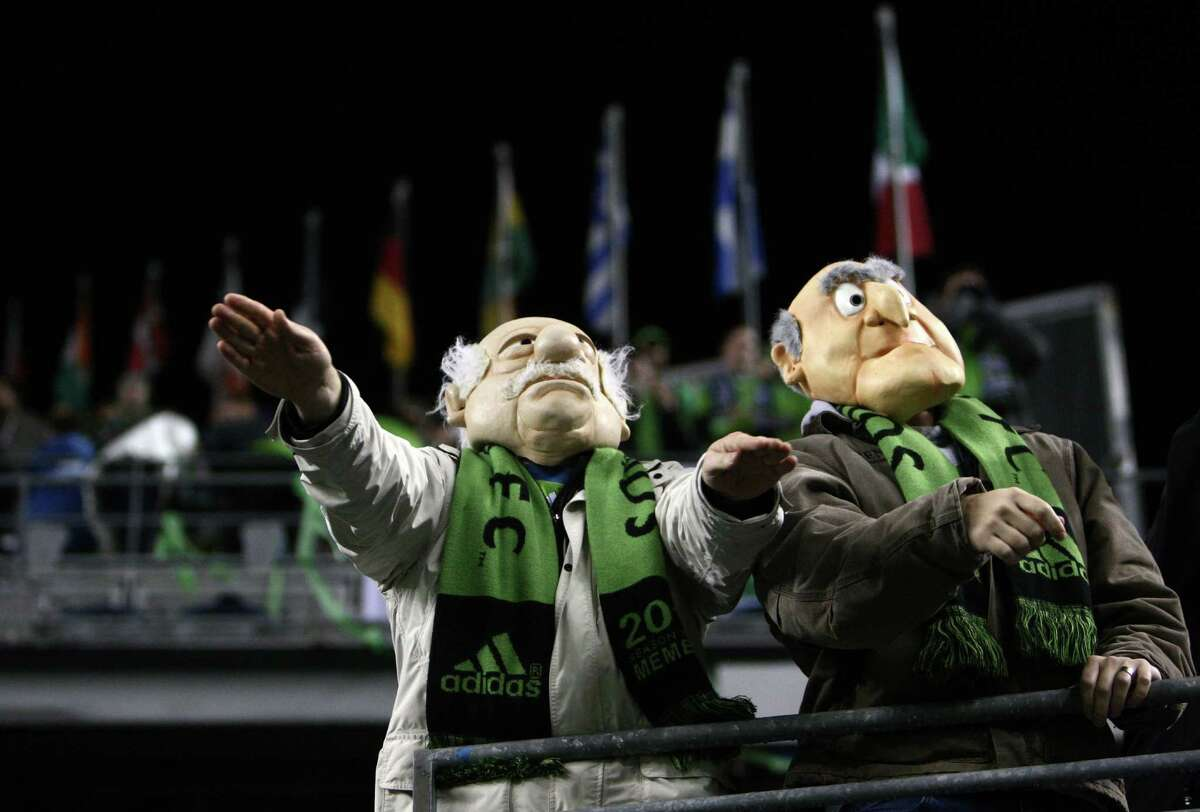 Fans dressed as Waldor and Statler, the the grumpy old men from the Muppets, boo officials during an MLS Western Conference semifinal game against Real Salt Lake on Friday, November 2, 2012 at CenturyLink Field in Seattle.