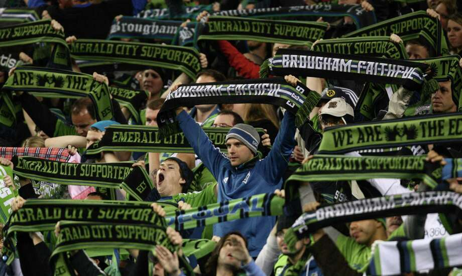 Seattle Sounders fans raise their scarfs against Real Salt Lake during an MLS Western Conference semifinal on Friday, November 2, 2012 at CenturyLink Field in Seattle. Photo: JOSHUA TRUJILLO / SEATTLEPI.COM