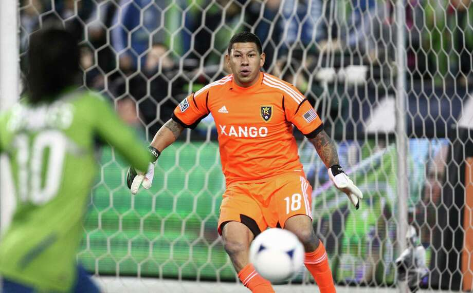 Real Salt Lake goalie Nick Rimando prepares to stop a ball kicked by Sounders player Mauro Rosales during an MLS Western Conference semifinal on Friday, November 2, 2012 at CenturyLink Field in Seattle. Photo: JOSHUA TRUJILLO / SEATTLEPI.COM