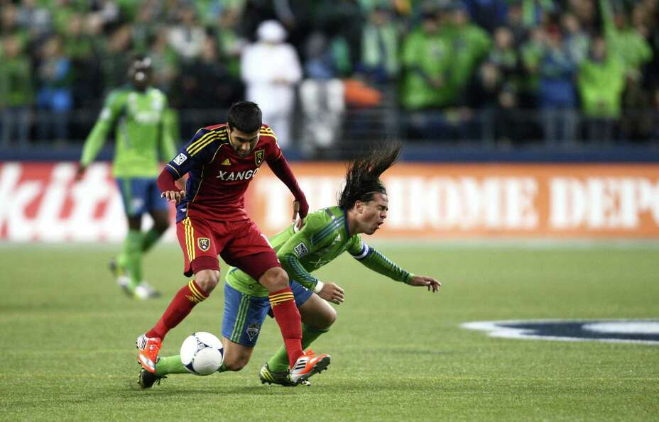 Real Salt Lake player Javier Morales (11) tangles with Seattle Sounders player Mauro Rosales during