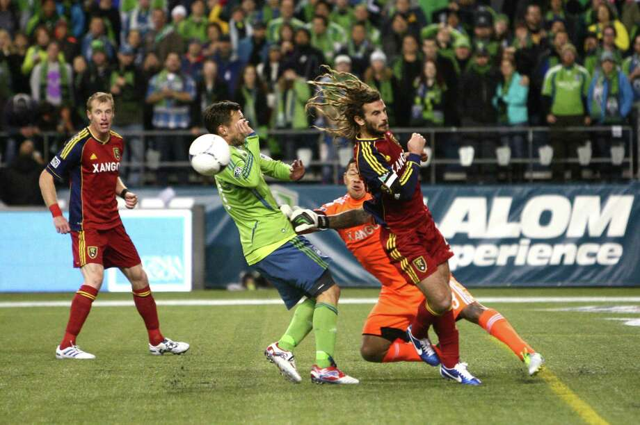 Seattle Sounders player Christian Tiffert, Real Salt Lake goalie Nick Rimando and RSL player Kyle Beckerman collide during an MLS Western Conference semifinal on Friday, November 2, 2012 at CenturyLink Field in Seattle. Rimando was injured in the play. Photo: JOSHUA TRUJILLO / SEATTLEPI.COM