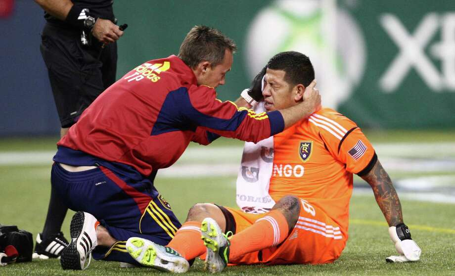 Real Salt Lake goalie Nick Rimando is attended to after he was kicked in the head during an MLS Western Conference semifinal on Friday, November 2, 2012 at CenturyLink Field in Seattle. Photo: JOSHUA TRUJILLO / SEATTLEPI.COM