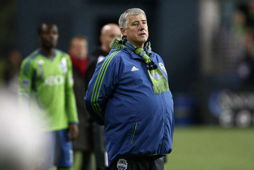 Seattle Sounders coach Sigi Schmid watches the action against Real Salt Lake during an MLS Western C