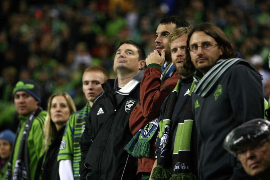 Fans watch the action against Real Salt Lake during an MLS Western Conference semifinal on Friday, November 2, 2012 at CenturyLink Field in Seattle. Photo: JOSHUA TRUJILLO / SEATTLEPI.COM