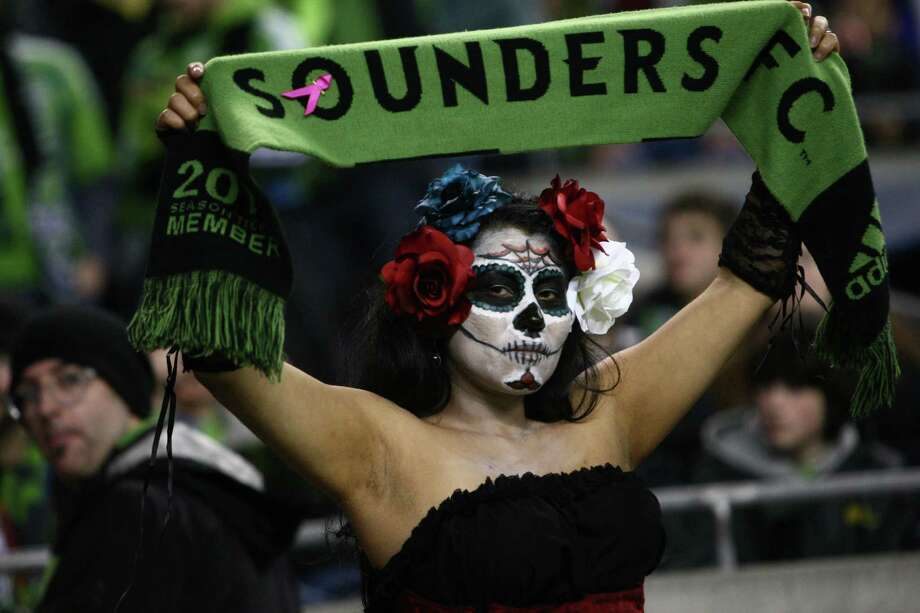 Gabriela Diaz holds up her Sounders scarf during an MLS Western Conference semifinal against Real Salt Lake on Friday, November 2, 2012 at CenturyLink Field in Seattle. Photo: JOSHUA TRUJILLO / SEATTLEPI.COM