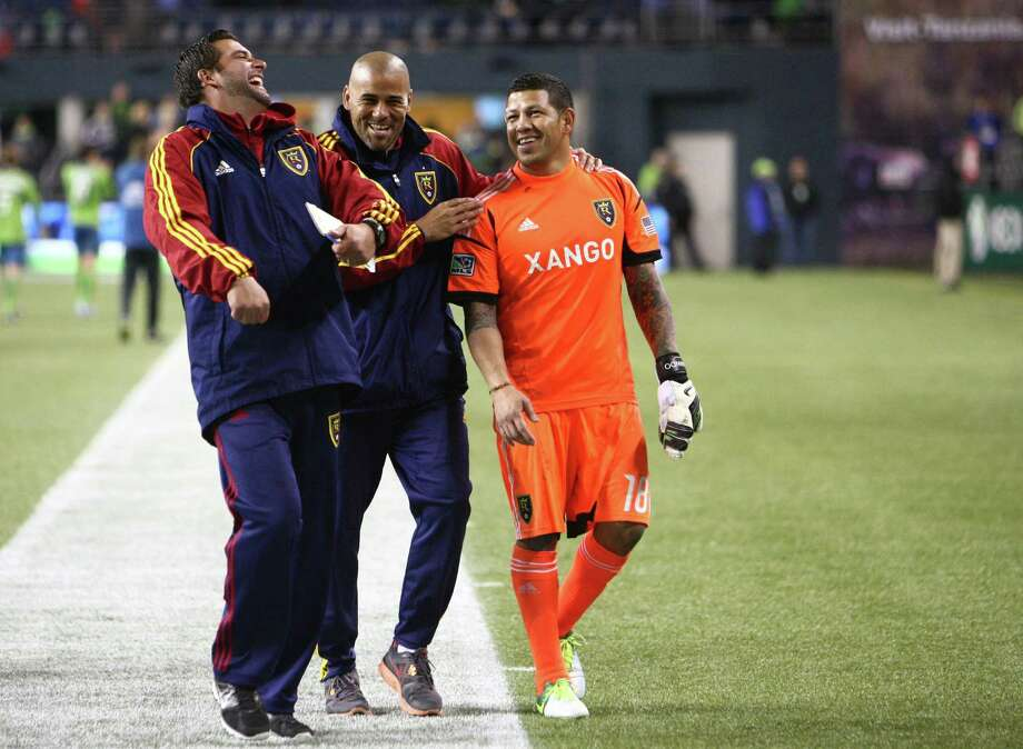Real Salt Lake goalie Nick Rimando laughs with coaches as he departs the field to the boos of Seattle Sounders fans after an MLS Western Conference semifinal on Friday, November 2, 2012 at CenturyLink Field in Seattle. Photo: JOSHUA TRUJILLO / SEATTLEPI.COM