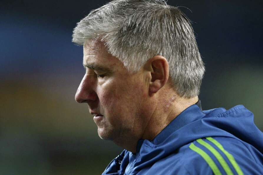 Seattle Sounders coach Sigi Schmid departs the field after a draw with Real Salt Lake during the MLS