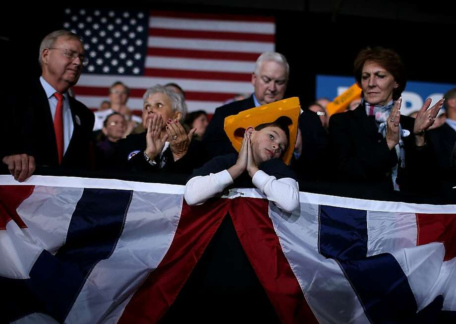 Supporters of Republican presidential candidate, former Massachusetts Gov. Mitt Romney look on during a campaign rally at the Wisconsin Products Pavilion at State Fair Park on November 2, 2012 in West Allis, Wisconsin. With less than one week to go before election day, Mitt Romney is campaigning in Wisconsin and Ohio. Photo: Justin Sullivan, Getty Images
