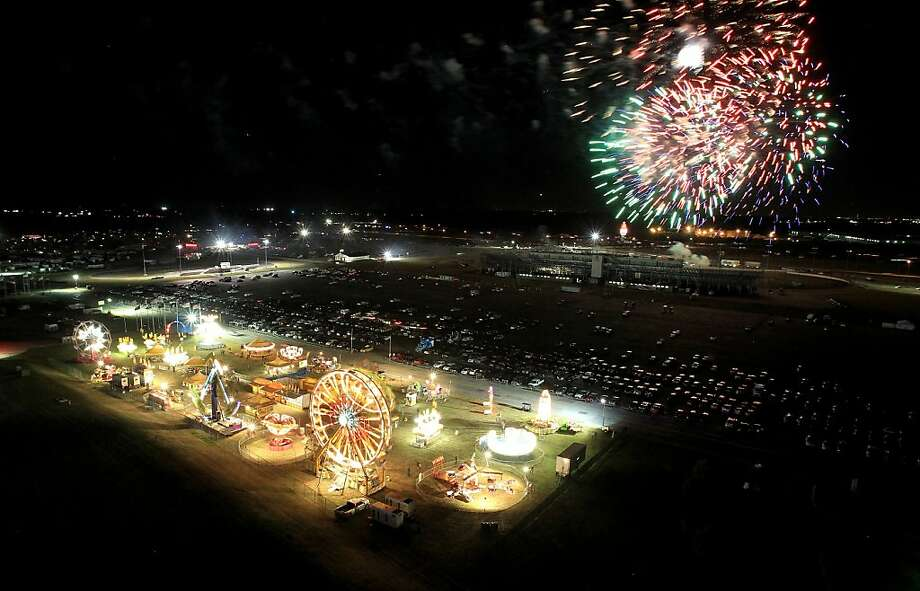 Fireworks are seen over the Carnival area during the NASCAR Camping World Truck Series WinStar World Casino 350k at Texas Motor Speedway on November 2, 2012 in Fort Worth, Texas. Photo: Ronald Martinez, Getty Images