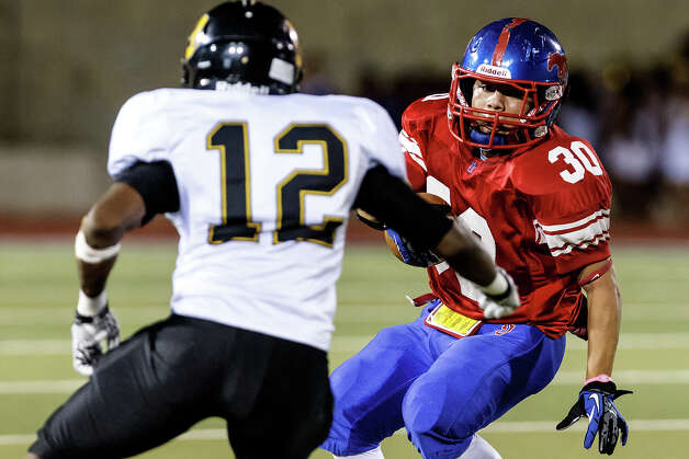 Jefferson's Joseph Luna (right) looks for a way around Brennan's Christopher Douglas during the third quarter of their game at Alamo Stadium on Nov. 2, 2012.  Brennan won the game 14-0.  MARVIN PFEIFFER/ mpfeiffer@express-news.net Photo: MARVIN PFEIFFER, Express-News / Express-News 2012