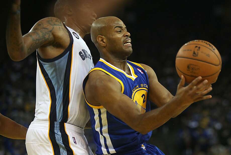 Warriors Jarrett Jack  tries to get past Grizzlies Jerryd Bayless during the first half as the Golden State Warriors play the Memphis Grizzlies at Oracle arena in Oakland, Calif.,  on Friday, November 2, 2012. Photo: Liz Hafalia, The Chronicle