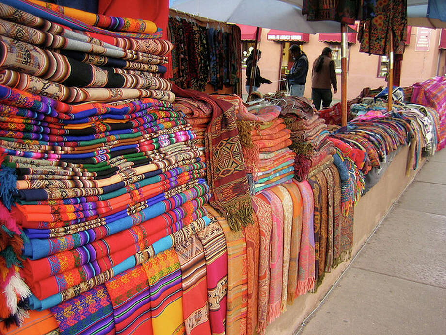 NEW MEXICO: Santa Fe, where these blankets were for sale, has trimmed its name from La Villa Real de la Santa Fé de San Francisco de Asís. The city was settled 30 years before the first ship from England landed at Plymouth Rock. claire.whitehouse/Flickr Creative Commons