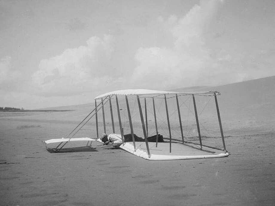 """The people I write about don't quit,"" says historian David McCullough. Before the Wright brothers flew with an engine, they had to practice gliding for years at Kitty Hawk. This 1901 photo shows Wilbur, who endured many hard landings."