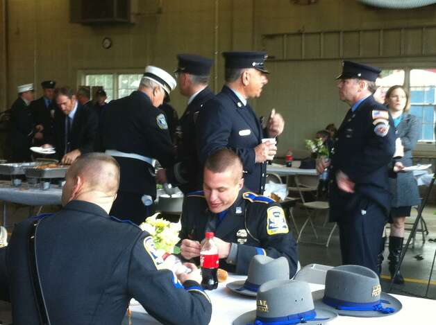 A memorial mass was held for fallen Easton Lt. Russell Neary who was killed during the height of Sandy on Monday when a tree fell on his fire truck. Photo: Stacy Davis / Connecticut Post