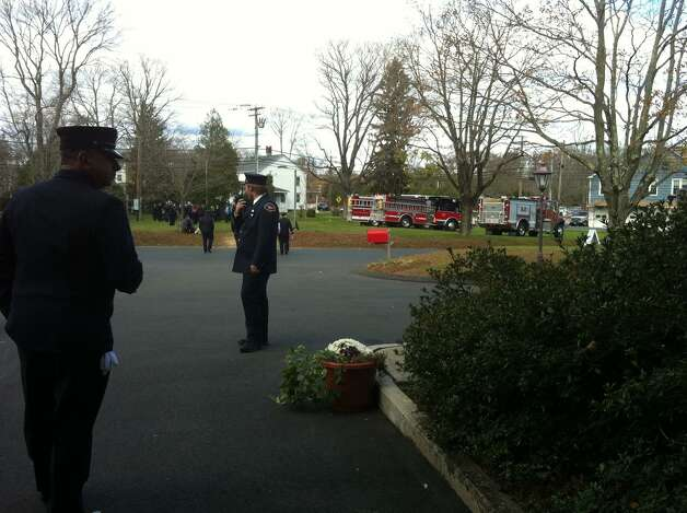 A memorial mass was held for fallen Easton Lt. Russell Neary who was killed during the height of Sandy on Monday when a tree fell on him. Photo: Stacy Davis / Connecticut Post