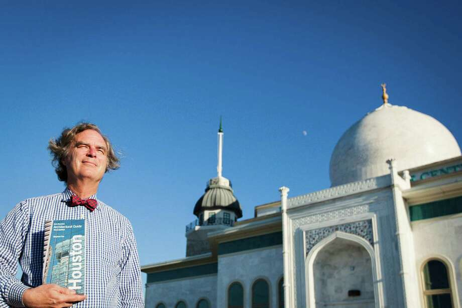 "Stephen Fox poses for a photo in front of the Istanbul Convention And Exhibition Center at the Raindrop Turkish House while holding the 3rd eddition of his book the ""American Institute of Architects Houston Architectural Guide"", Tuesday, Oct. 23, 2012, in Houston. ( Michael Paulsen / Houston Chronicle ) Photo: Michael Paulsen, Staff / Houston Chronicle"