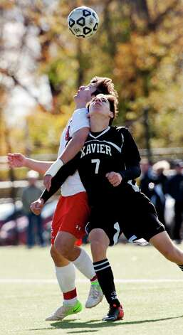 Xavier high school's Sam Oeschger and Fairfield Prep high school's Stephen Tortora battle for the ball in a Southern Connecticut Conference boys soccer semifinal playoff game held at Alumni field Fairfield University, Fairfield CT on Saturday November 3rd 2012. Photo: Mark Conrad / Connecticut Post Freelance