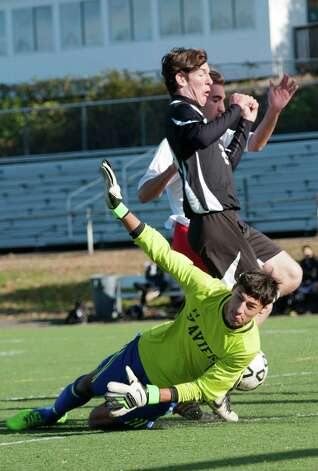 Xavier high school goalie Zach Camner dives to make a save in the Southern Connecticut Conference boys soccer semifinal playoff game against Fairfield Prep high school held at Alumni field Fairfield University, Fairfield CT on Saturday November 3rd 2012. Photo: Mark Conrad / Connecticut Post Freelance