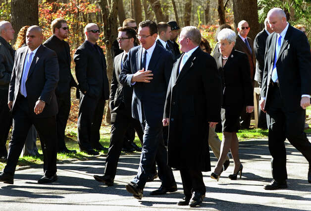 Governor Dannel P. Malloy, center, leaves after attending the funeral and memorial mass of firefighter Russell Neary at Notre Dame Roman Catholic Church in Easton, Conn. on Saturday November 3, 2012. Neary died when a tree fell on him as he was on duty during Hurricane Sandy this past Monday. Photo: Christian Abraham / Connecticut Post