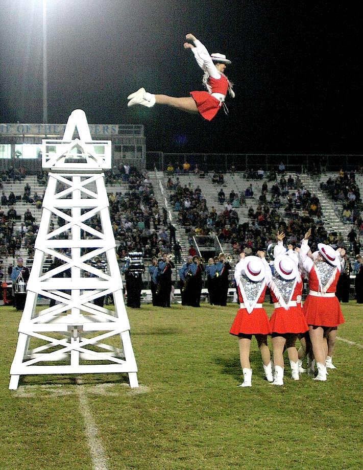 The Raiderettes performed the Derrick Routine at Friday night's game against Nederland. Macie Humble flies through the air to the delight of the Raider fans. Photo: David Lisenby, Freelance