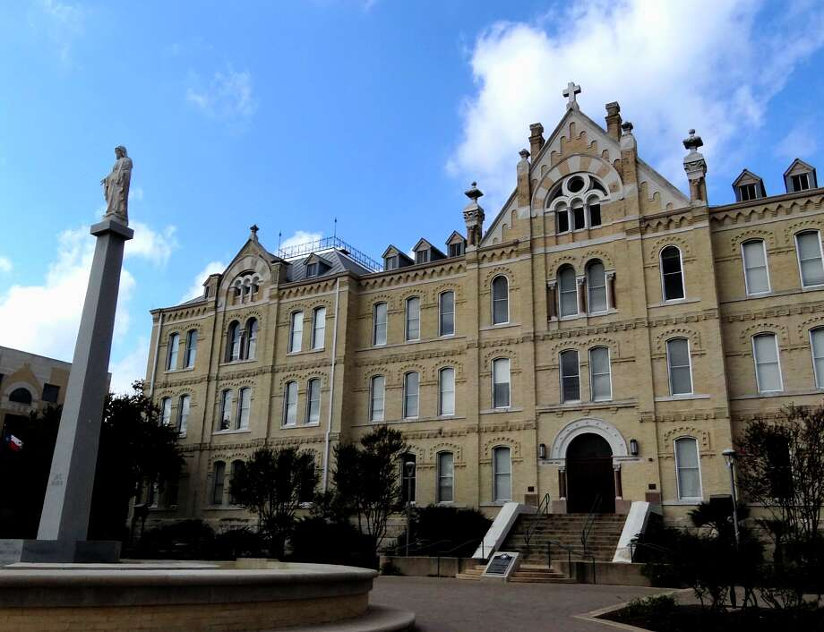 St. Mary's University's St. Louis Hall, is a 118-year-old structure. The university has recently restored it through a $6.1 million preservation project. Photo: Billy Calzada, San Antonio Express News / San Antonio Express News