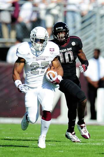 LaDarius Perkins #27 of the Mississippi State Bulldogs runs for yards against the Texas A&M Aggies.