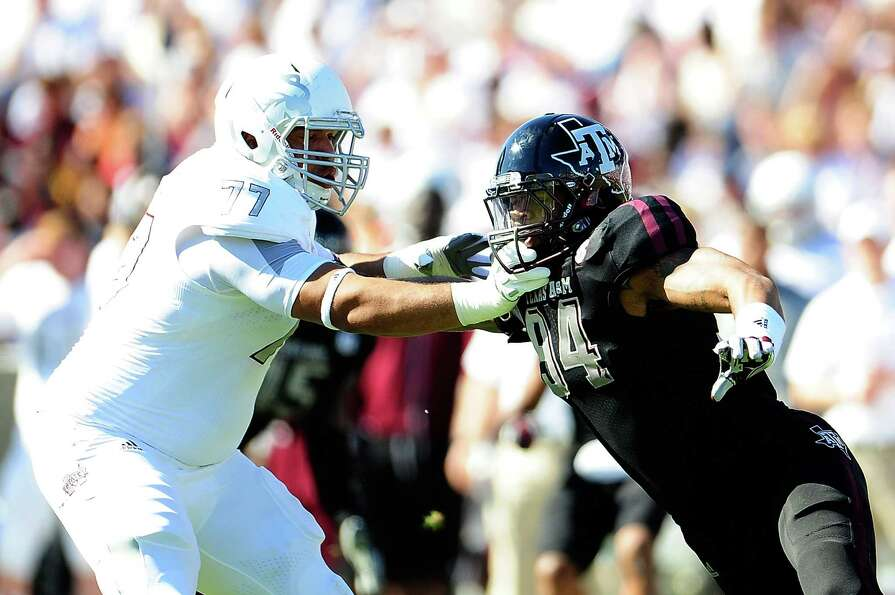 Damontre Moore #94 of the Texas A&M Aggies rushes against Joey Trapp #77 of the Mississippi State Bu