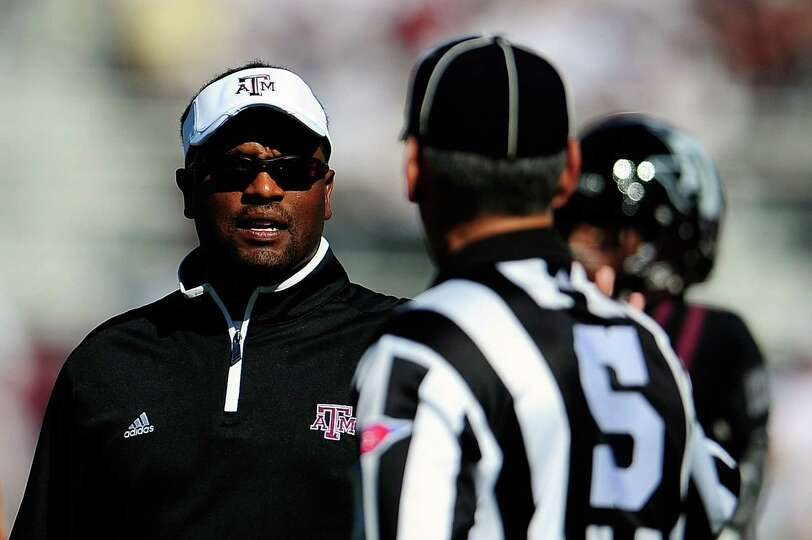 Head coach Kevin Sumlin of the Texas A&M Aggies discusses a call with an official.