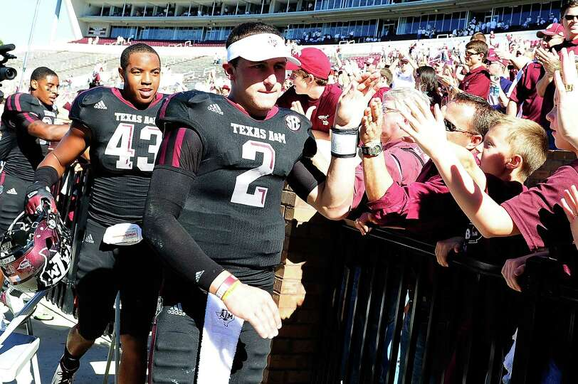 Texas A&M - 31 Mississippi State - 13Texas A&M quarterback Johnny Manziel greets fans aft