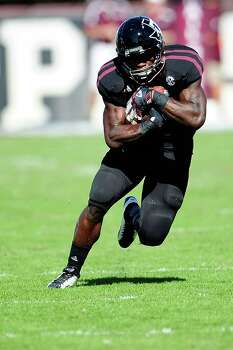 Christine Michael #33 of the Texas A&M Aggies runs for yards against the Mississippi State Bulldogs. Photo: Stacy Revere, Getty Images / 2012 Getty Images