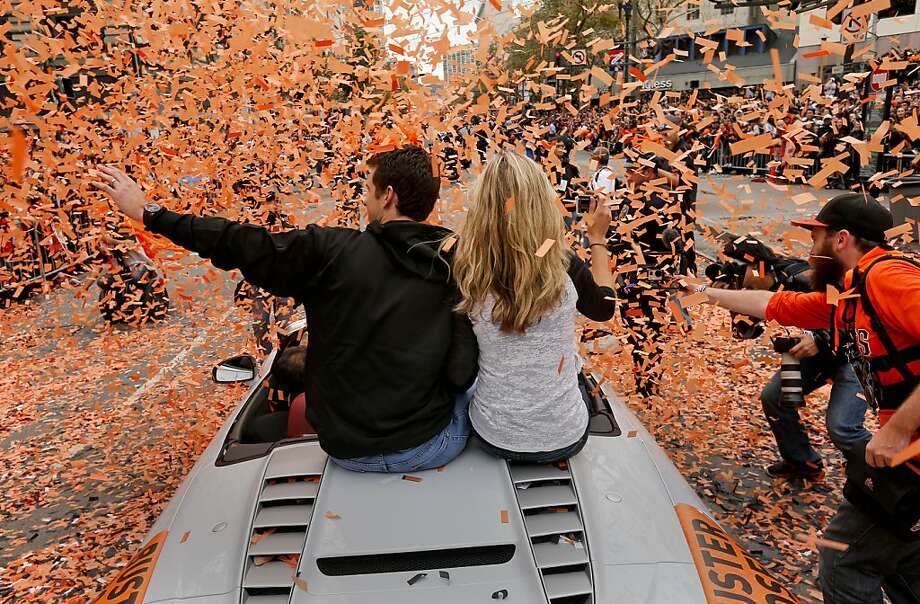 Giants' catcher Buster Posey and his wife Kristen pass through a stream of confetti as the San Francisco Giants celebrated their World series Championship with a parade up Market Street in downtown San Francisco, Calif., on Wednesday Oct. 31, 2012. Photo: Michael Macor, The Chronicle