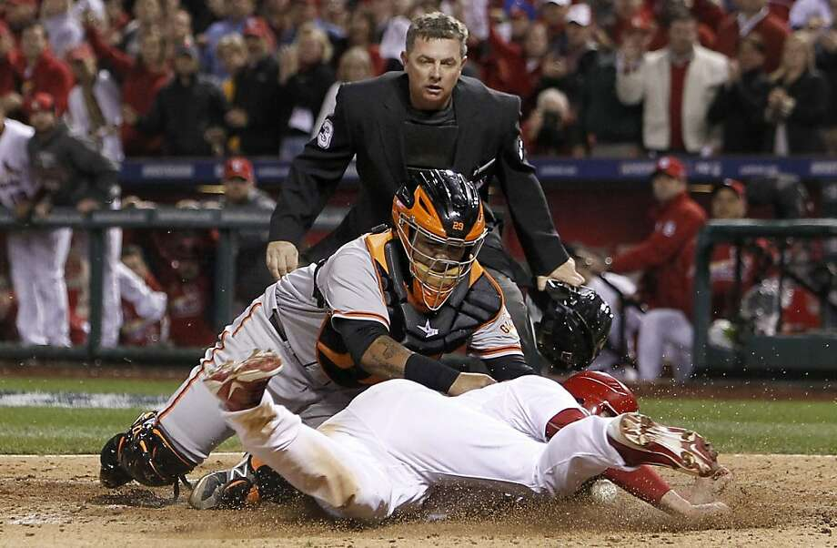 The Cardinals' Matt Carpenter is safe at home as the ball got loose from Giants catcher Hector Sanchez in the fifth inning, as the San Francisco Giants take on the St. Louis Cardinals in game four of the National League Championship Series, on Thursday Oct. 18, 2012 at Busch Stadium , in  St. Louis, Mo. Photo: Michael Macor, The Chronicle