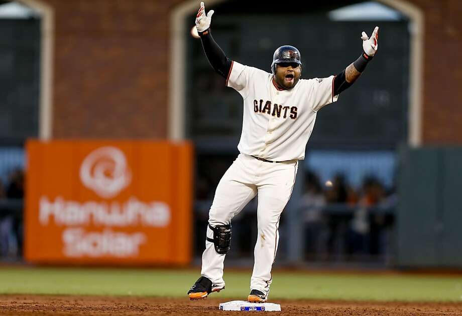 Giants' Pablo Sandoval celebrates his double in the third inning,  as the San Francisco Giants went  on to beat the St. Louis Cardinals 9-0 in game seven to win the National League Championship Series, on Monday Oct. 22, 2012 at AT&T Park, in  San Francisco, Calif. Photo: Michael Macor, The Chronicle