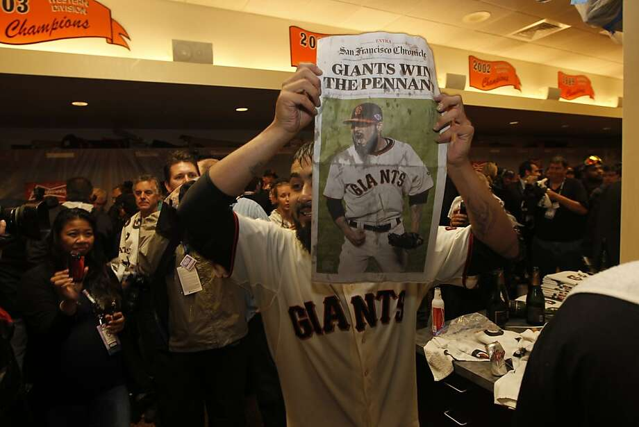 San Francisco  pitcher Sergio Romo displays a newspaper telling of their win  as they celebrate their victory over the St. Louis Cardinals 9-0 to win the NLCS Championship game at AT&T Park Monday, Oct. 22, 2012 in San Francisco, Calif. Photo: Michael Macor, The Chronicle