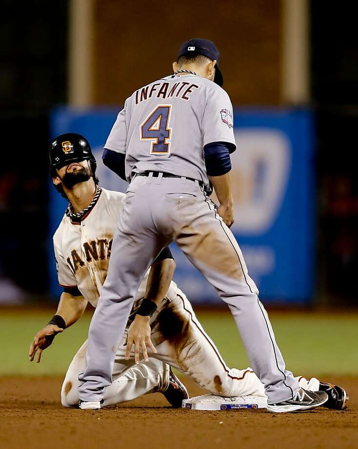 Giants' Angel Pagan safely steals second base in front of the Tigers' Omar Infante in the eighth inning, as the San Francisco Giants went on to beat the Detroit Tigers 2-0, in game two of the World Series, on Wednesday Oct. 24, 2012 at AT&T Park, in  San Francisco, Calif. Photo: Michael Macor, The Chronicle