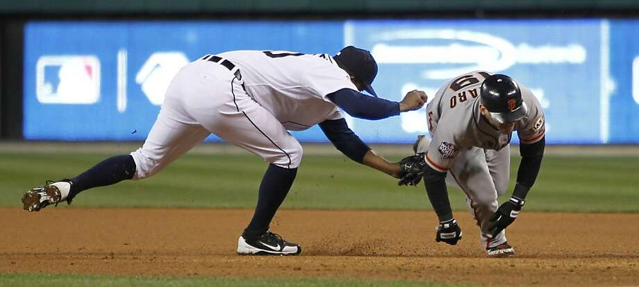 Giants' 2nd baseman Marco Scutaro is caught in a rundown between 1st and 2nd bases by Tigers' pitcher Octavio Dotel in the 8th inning during game 4 of the World Series at Comerica Park on Sunday, Oct. 28, 2012 in Detroit, MI. Photo: Michael Macor, The Chronicle