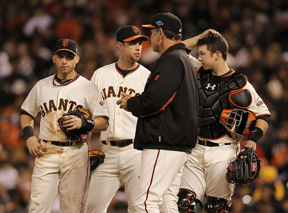 (l to r) Giants Marco Scutaro, Brandon Belt, manager Bruce Bochy and Buster Posey gather on the mound during a pitching change in the eighth inning, as the San Francisco Giants take on the Cincinnati Reds in game two of the National League Divisional Series at AT&T Park  San Francisco, Calif., on Sunday October 7, 2012. Photo: Michael Macor, The Chronicle