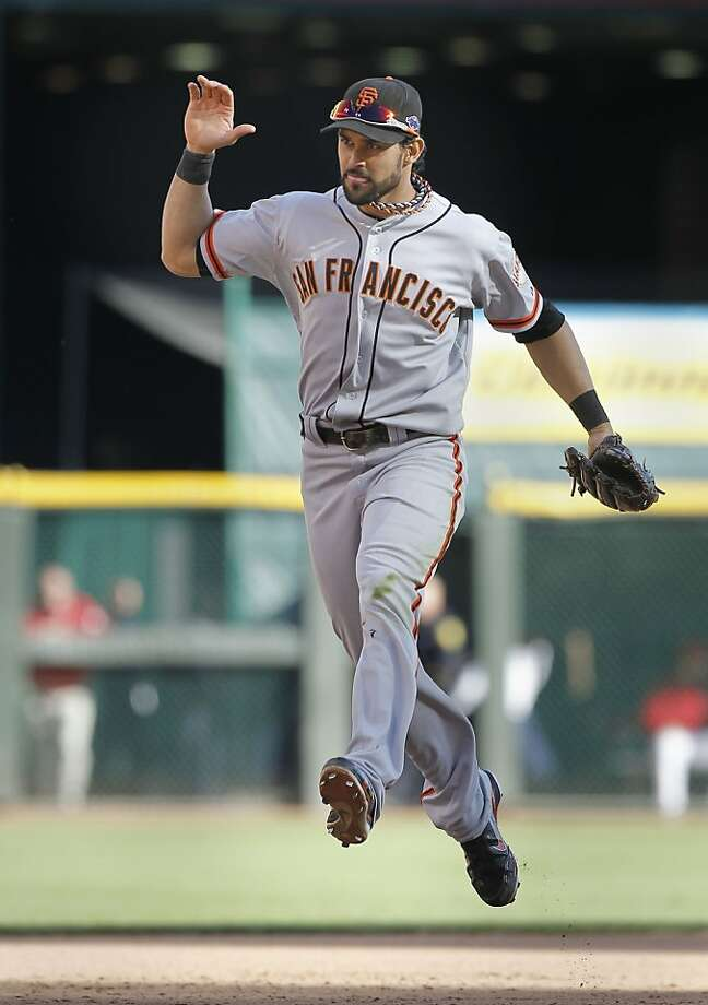 Giants' Angel Pagan celebrate his catch in the outfield in the eighth inning, to rob the Reds Dioner Navarro of hit, as the San Francisco Giants went on to beat on the Cincinnati Reds in game five and win the National League Division Series in Cincinnati, Ohio on Thursday Oct. 11, 2012. Photo: Michael Macor, The Chronicle