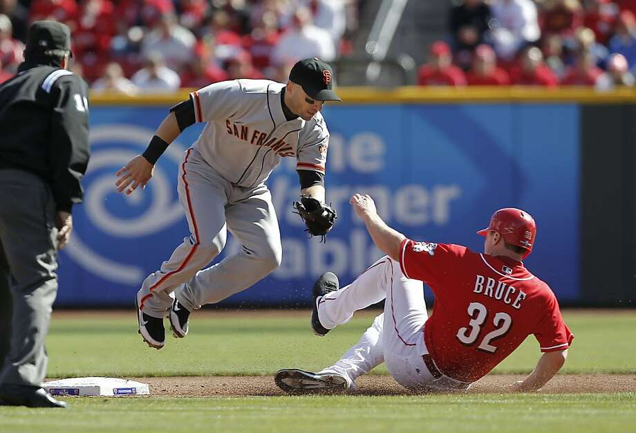 GIants Marco Scutaro forces out the Reds Jay Bruce to end the fourth inning, as the San Francisco Giants take on the Cincinnati Reds in game five of the National League Division Series in Cincinnati, Ohio on Thursday Oct. 11, 2012. Photo: Michael Macor, The Chronicle