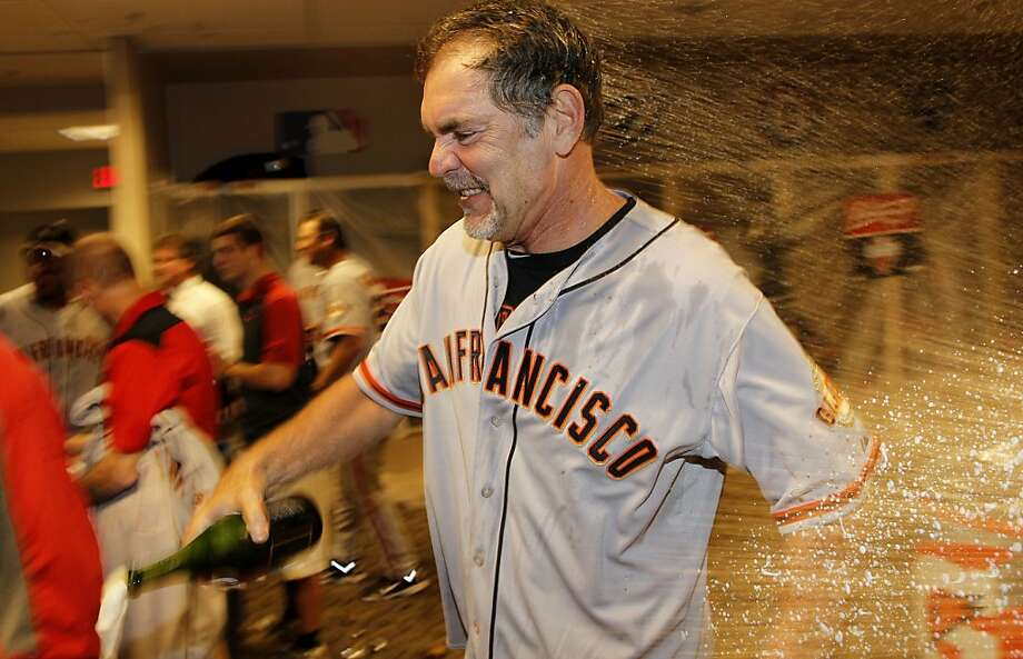 Giants' manager Bruce Bochy gets  a spray of champagne while the team celebrates in the clubhouse, as the San Francisco Giants beat the Cincinnati Reds 6-4 in game five to win the National League Division Series in Cincinnati, Ohio on Thursday Oct. 11, 2012. Photo: Michael Macor, The Chronicle