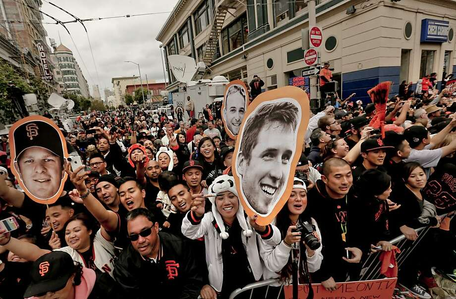 Fans filled the sidwalks as the San Francisco Giants celebrated their World Series Championship with a parade up Market Street in downtown San Francisco, Calif., on Wednesday Oct. 31, 2012. Photo: Michael Macor, The Chronicle