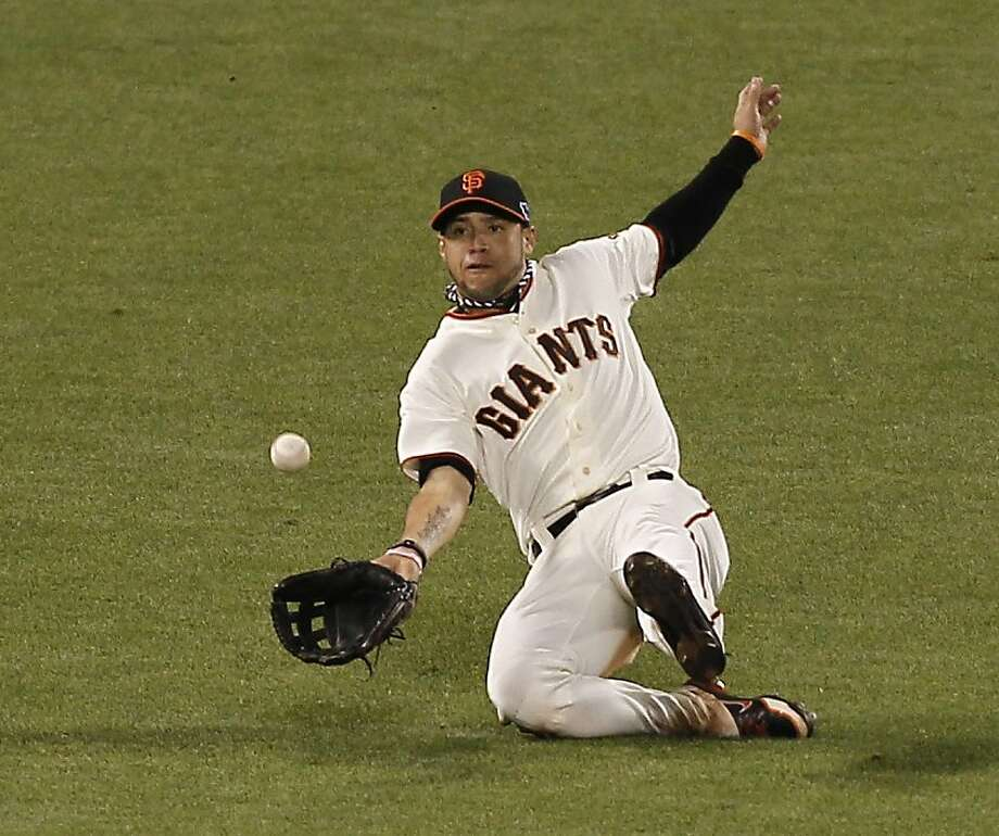 GiantsÕ left fielder Gregor Blanco makes the catch on a CardinalsÕ second baseman Skip Schumaker liner to left to  during game 1 of the NLCS at AT&T Park on Sunday, Oct. 14, 2012 in San Francisco, Calif. Photo: Michael Macor, The Chronicle