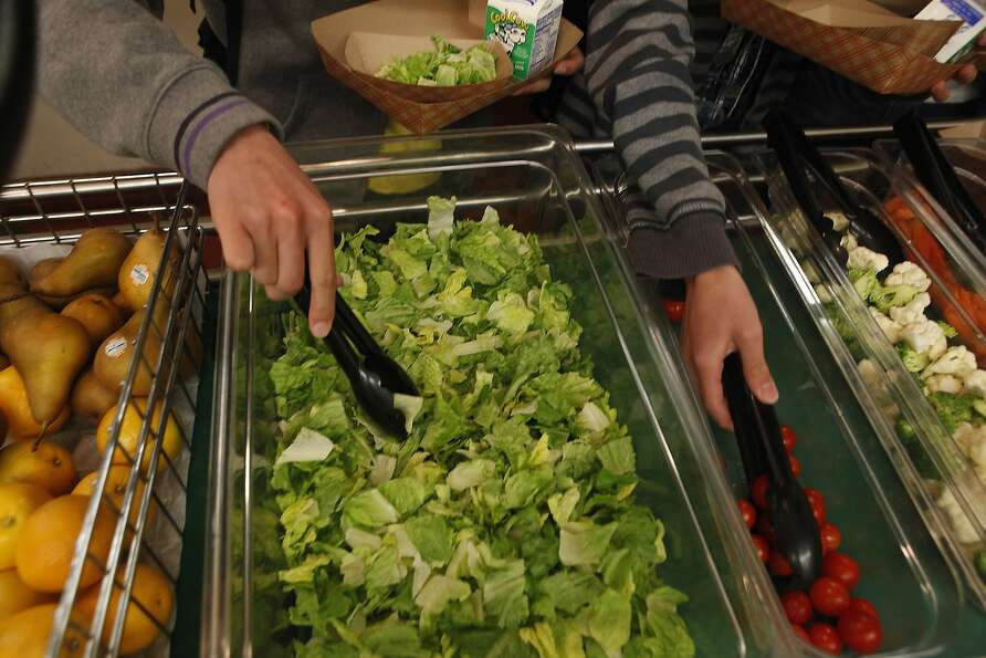 Students help themselves to salad at Francisco Middle School in the San Francisco Unified School Dis
