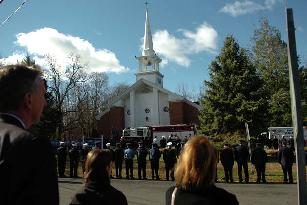A funeral and memorial mass was held for Easton firefighter Russell Neary at Notre Dame Roman Catholic Church in Easton, Conn. on Saturday November 3, 2012. Neary died when a tree fell on him as he was on duty during Hurricane Sandy this past Monday. Photo: Christian Abraham / Connecticut Post