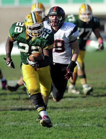 Trinity Catholic's Shaquan Howsie carries the ball during Saturday's football game against Fairfield Warde at Trinity Catholic High School in Stamford, Conn., on October 20, 2012. Photo: Lindsay Niegelberg / Stamford Advocate