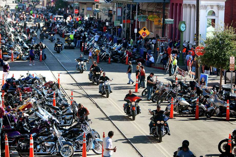 "Bikers ride as they look for a place to park during the Lone Star Rally Saturday, Nov. 3, 2012, in Galveston. The Rally featured different events including a free concert by Bret Michaels, different bike shows and some of the world's top bike builders along with a guest appearance from Charlie ""Jax"" Hunnam from the hit show, ""Sons of Anarchy."" Photo: Cody Duty, Houston Chronicle / © 2012 Houston Chronicle"