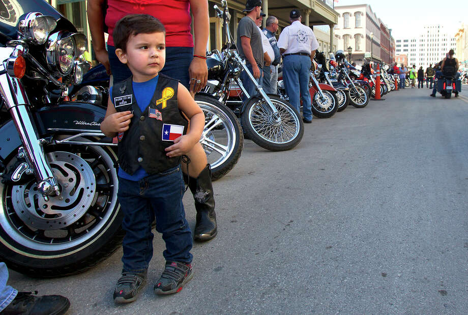 "Michael Ezrael, 2, watches as bikes ride by during the Lone Star Rally Saturday, Nov. 3, 2012, in Galveston. The Rally featured different events including a free concert by Bret Michaels, different bike shows and some of the world's top bike builders along with a guest appearance from Charlie ""Jax"" Hunnam from the hit show, ""Sons of Anarchy."" Photo: Cody Duty, Houston Chronicle / © 2012 Houston Chronicle"