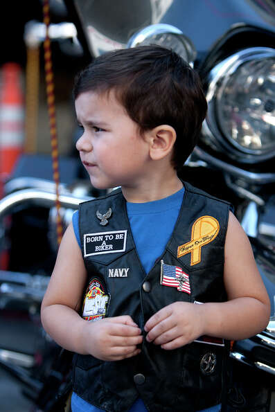 Michael Ezrael, 2, watches as bikes ride by during the Lone Star Rally Saturday, Nov. 3, 2012, in Ga