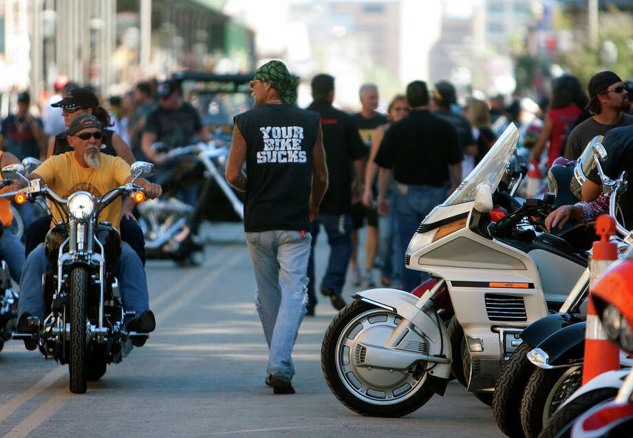 "Bikers ride as they look for a place to park during the Lone Star Rally Saturday, Nov. 3, 2012, in Galveston. The Rally featured different events including a free concert by Bret Michaels, different bike shows and some of the world's top bike builders along with a guest appearance from Charlie âÄúJaxâÄù Hunnam from the hit show, âÄúSons of Anarchy."" Photo: Cody Duty, Houston Chronicle / © 2012 Houston Chronicle"